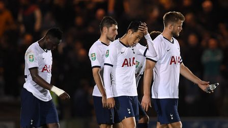 Tottenham Hotspur's Son Heung-min and players look dejected after the Carabao Cup, Third Round match