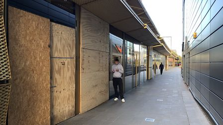The shop Present has been boarded up since it was ram raided twice, and the shutters have still not