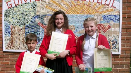 The three children - Rafe Dewsnap, Felix Dewsnap and Jessica Pritchard - who won awards in the 15th