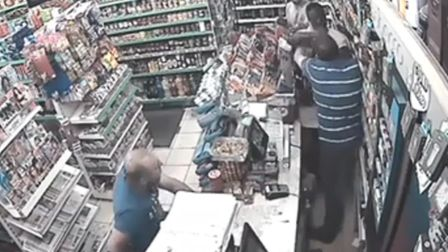 The customer and shopkeeper scuffling in Star Market moments before the stabbing.