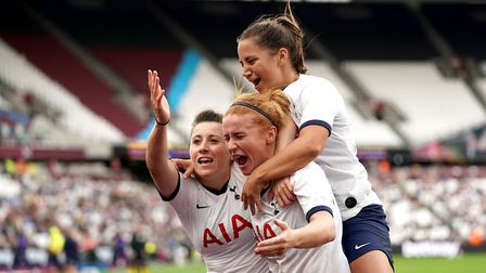 Tottenham Hotspur women's Lucy Quinn, (left) celebrates scoring their second goal of the game during