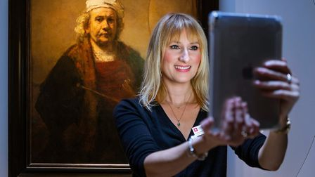 Louise Cooling, Assistant Curator, takes a selfie in front of Rembrandt's Self Portrait With Two Cir