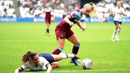 West Ham United women's Alisha Lehmann, (right) battles for possession of the ball with Tottenham Ho