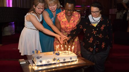 Wave founders Celia Webster and Bernice Hardie cutting the Wave cake with their daughters. Picture: