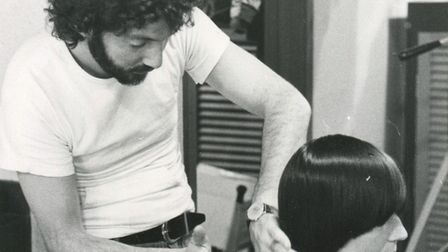 David Barron working on a client's hair. Picture: David Barron