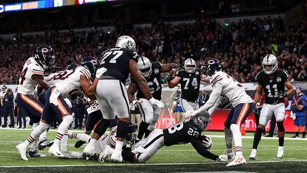 Oakland Raiders Josh Jacobs scores his side's 1st touchdown during the NFL International Series matc