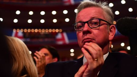Michael Gove watches Prime Minister Theresa May delivers her keynote speech at the Conservative conf