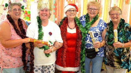 Zoiyar Cole, Janet Ellis and friends at the Christmas coffee morning they held in July last year. Pi
