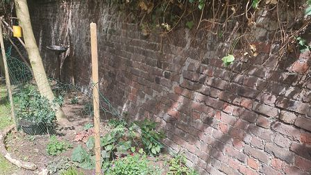 The Victorian wall separating the estate from the building site