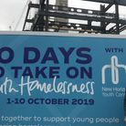 New Horizon Youth Centre's Phil Kerry in front of the hoardings for the 10 Days to Take On Youth Hom