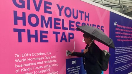 Hoardings outside of King's Cross enable people to 'tap to donate' to New Horizon Youth Centre. Pict