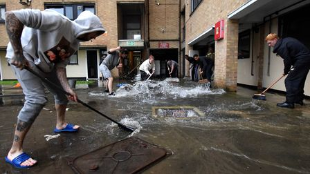 Flood water on the Kings Crescent Estate N4. Residents clean up. Picture: Polly Hancock