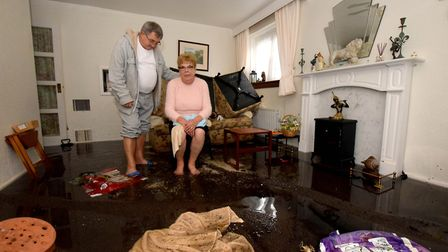 Flood water on the Kings Crescent Estate N4. Brian Bicknell looks at the debris in the living room o