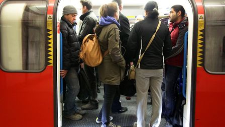 Commuters pack on to a Tube train. Pictures: PA Images/Yui Mok