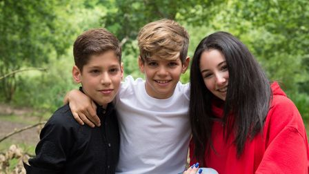 Rafi (centre) with his brother Zak (left) and Jessy (right), who Great Ormond Street Hospital helped