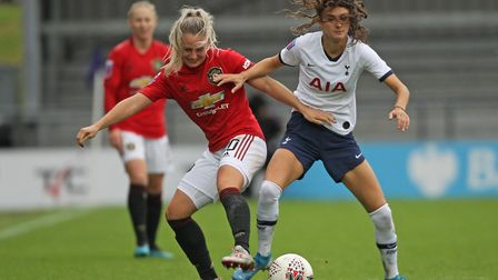 Manchester United's Kirsty Smith (left) and Tottenham Hotspur's Rosella Ayane battle for the ball du
