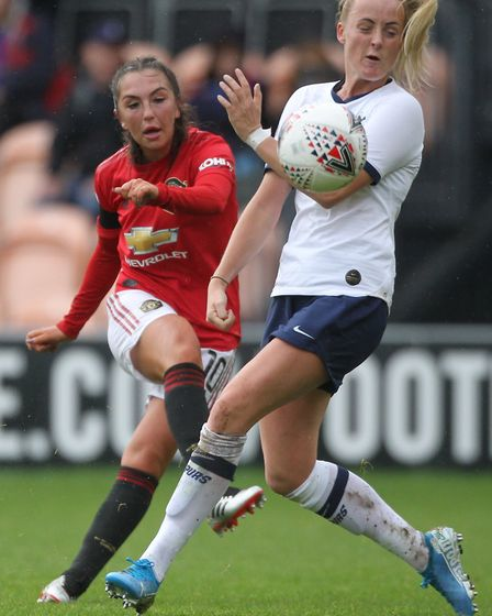 Manchester United's Katie Zelem (left) and Tottenham Hotspur's Chloe Peplow battle for the ball duri