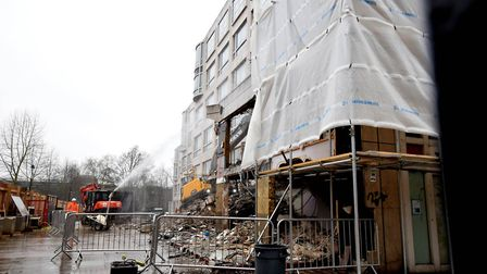 Viewed through the gate, demolition of part of the site at 100 Avenue Road has begun. Picture: Polly