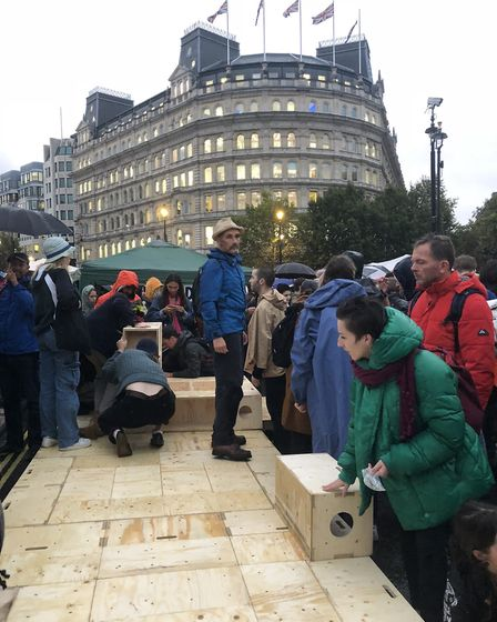 Actor Mark Rylance joins Extinction Rebellion protestors from Hackney in building a stage in the roa