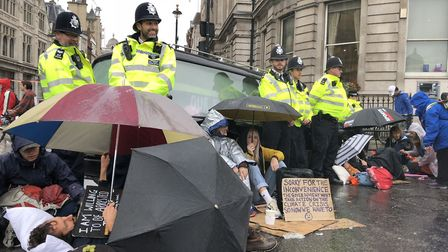 Extinction Rebellion campaigners from the Hackney group block Trafalgar Square with a hearse. The dr