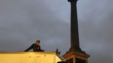 An Extinction Rebellion protestor glued to the top of a trailer in Trafalgar Square. Picture: Emma B