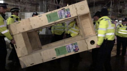 Police confiscate a wooden structure from Extinction Rebellion in Trafalgar Square. Picture: Emma Ba