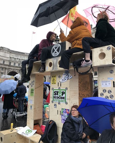 XR campaigners erect a wooden structure to block traffic entering Trafalgar Square. Picture: Emma Ba