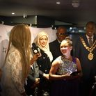 Roshelle White receives one of her two awards from organiser Cherie Antoinette. Picture: Anthony and