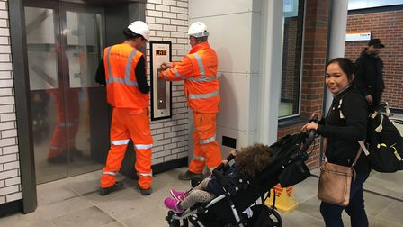 Joy with her two children are the first customers to use the new lifts at West Hampstead Overground
