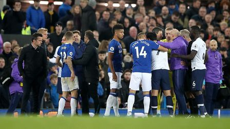 Tottenham Hotspur's Son Heung-min is consoled after being sent off for a challenge on Everton's Andr