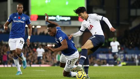 Tottenham Hotspur's Son Heung-min (right) tangles with Everton's Yerry Mina resulting in a check of