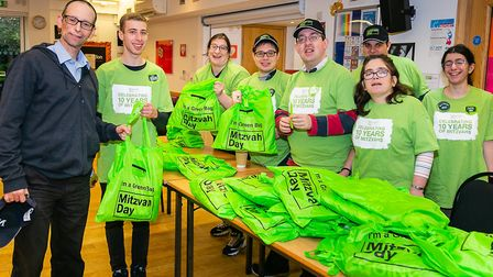 Members of charity Langdon give out Mitzvah Day goodies to volunteers. Picture: Yakir Zur