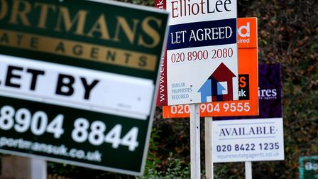 To let and for sale property boards on Watford Road in Sudbury, London. The annual rate at which hou