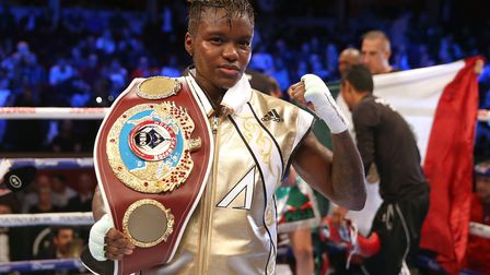 Nicola Adams poses with the belt after a split decision in her WBO world flyweight championship bout