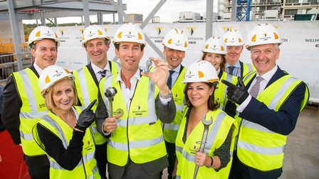 """Trevor Pears and Royal Free Hospital staff on top of the Pears Building before the """"topping out"""" cer"""