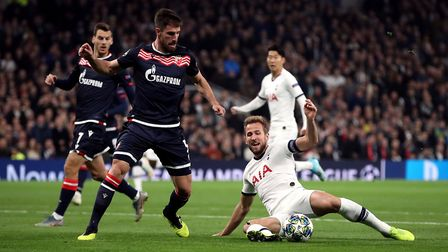 Tottenham Hotspur's Harry Kane falls as he attempts to shoot during the UEFA Champions League Group