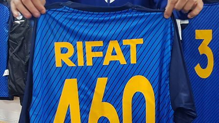 Ahmet Rifat poses with a 460 shirt after breaking the club record (Pic: Khalid Karimullah)