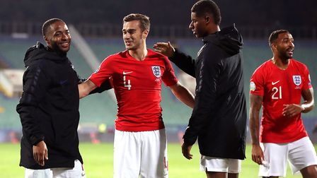 England's Raheem Sterling, Harry Winks, Marcus Rashford and Callum Wilson after the final whistle in
