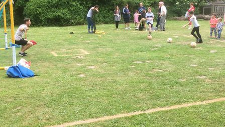 Mr Kounnas in goal for the beat the goalie contest at the Gunton Primary Academy school fete. Pictur