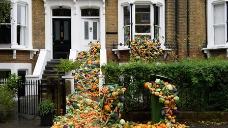 The amount of food binned by just 14 households in one year has been arranged outside a house in Col
