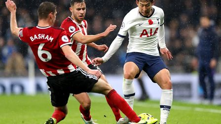 Tottenham Hotspur's Son Heung-min (right) battles for the ball with Sheffield United's George Baldoc