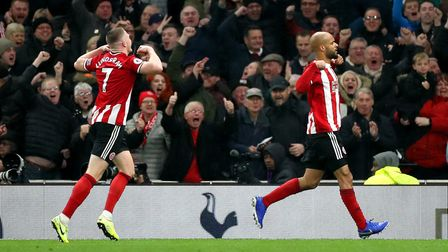 Sheffield United's David McGoldrick (right) celebrates after finding the net against Tottenham, befo