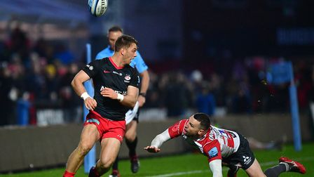 Saracens Alex Lewington and Gloucester's Tom Marshall during the Gallagher Premiership match at King