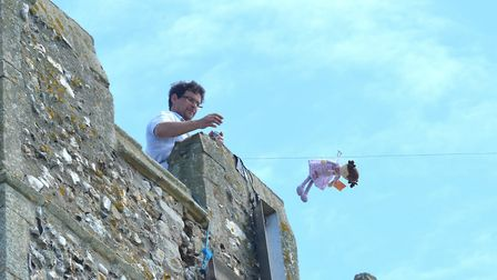 A brave teddy bear takes the plunge and sets off down the zip wire at last year's event. Photo Mick