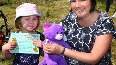 A young girl has her bear checked over by one of the teddy nurses at last year's fete. Photo Mick Ho