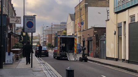 A bomb disposal robot is deployed in Holmes Road, Kentish Town, after a suspicious car was found. Th
