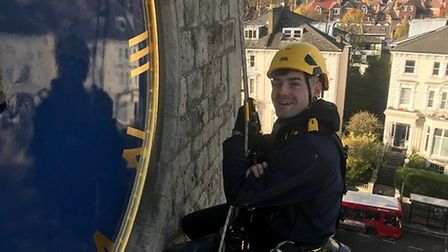 Mitch Eaton of Smith and Derby fixing the clock on St Peter's Church in Belsize Park. Picture: Kenne