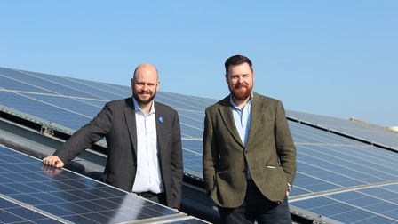 Mayor Phil Glanville and environment chief Cllr Jon Burke on the roof of the town hall, where solar