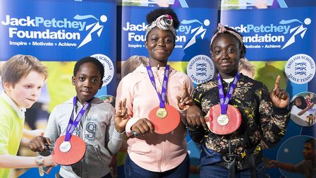 Ed Boakye, Victoria Boakye and Phoebe Boakye from The Wickers Charity celebrate their success for Ha
