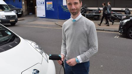 Cllr Adam Harrison with an electric vehicle charging point. Picturee: Camden Council